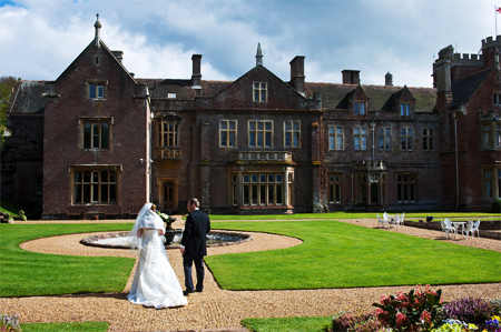Somerset wedding photography od bride and groom in front of St Audries near Minehead