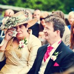 Mother of bride wipes away tears during ceremony at Bovey Castle wedding in devon