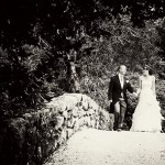Wedding couple photographed on the bridge in the grounds of Bovey Castle