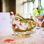 Photography of Bovey-Castle-Wedding-flower bowl with white and pink orchids