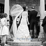 Couple during Bovey Castle wedding ceremony on terrace in Devon