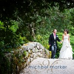 Bovey Castle wedding couple on the bridge in the gardens