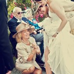 Wedding photographer at Bovey Castle captures bride and mums adjusting her garter.
