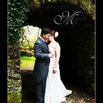 Wedding couple in grounds of Hotel Endsleigh on their wedding day at the shell grotto