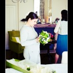 Bride getting ready Hotel Endsleigh wedding - looking at bouquet