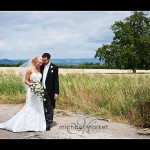 Somerset wedding couple in field with countryside in the background.