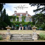 Somerset wedding venue Holbrook House with bride and guests on the terrace