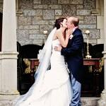 Kissing couple at Bovey Castle wedding in Devon