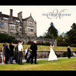 Bovey Castle wedding bride playing golf nearest the pin with guests watching.