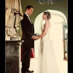 Bride and groom looking at each other in entrance hall of Haldon Belvedere wedding