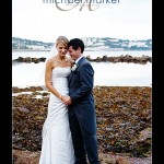 Bride and groom at Torquay wedding with sea in background