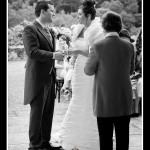 Bride and groom exchanging vows at Pentillie Castle wedding in Cornwall