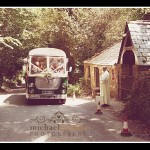 Vintage bus outside church for Truro wedding in Cornwall