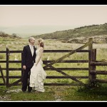 Bride and groom in gateway at Two Bridges Hotel wedding