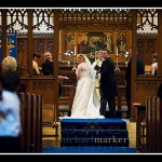Bride and groom looking at congregation during Plymouth Church wedding