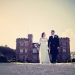 Wedding couple in front of Mount Edgecumbe House in Cornwall