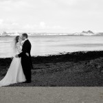 Mount Edgecumbe wedding kiss on the beach overlooking Plymouth