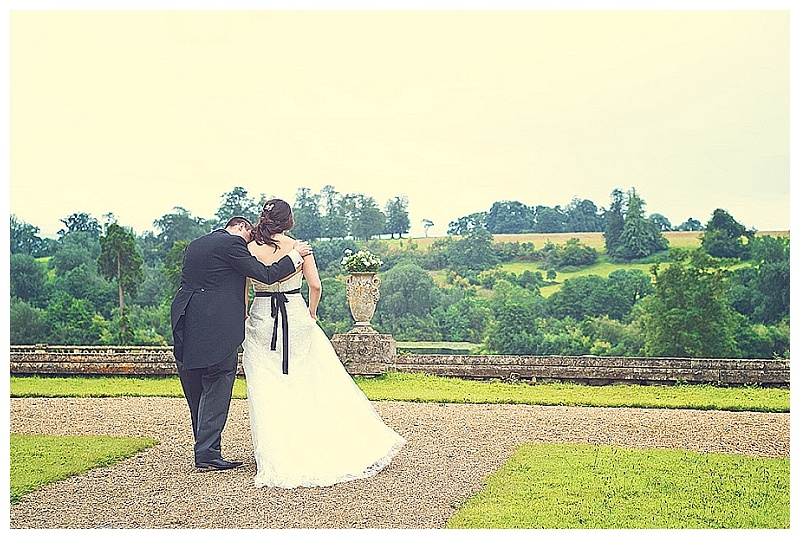 Bride and groom in the gardens of Orchardleigh House during wedding