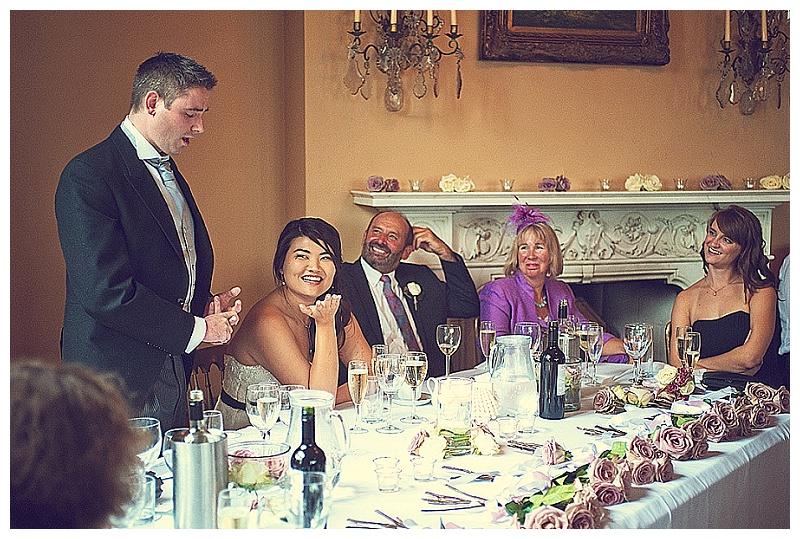 Wedding specches at orchardleigh House wedding - bride looking at groom