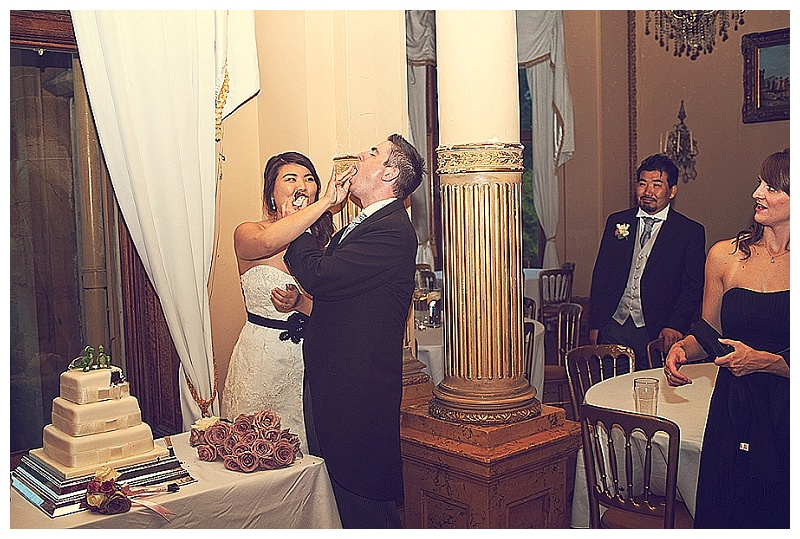 Bride and groom cutting the cake at Orchardleigh House