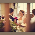 Bride and groom exchanging vows and rings at Devon Church wedding