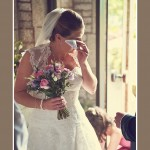 Bride wiping tears before Church wedding service in Newton Ferrers in Devon