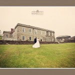 Bride and groom in front of beautiful wedding venue Shilstone House in Devon