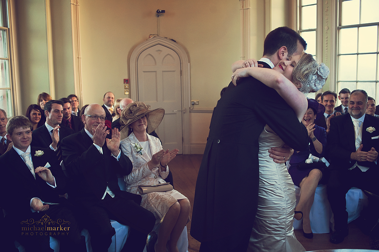 Bride and groom hug during Devon ceremony at Haldon Belvedere