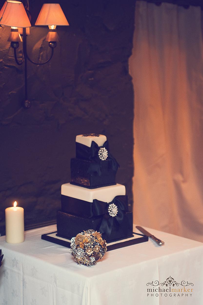 Black and white weding cake at Devon wedding