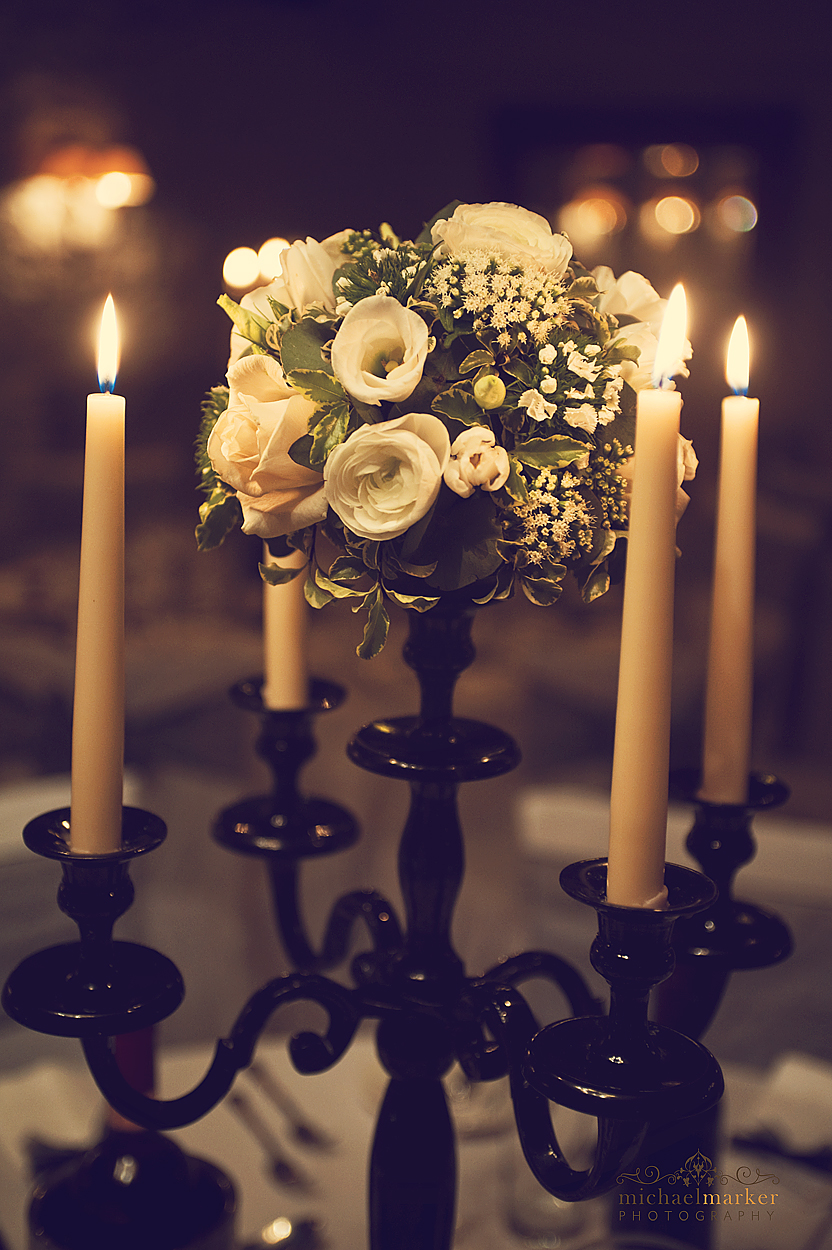 Floral table centre at Devon wedding reception in winter