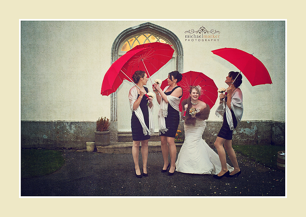 Brides and bridesmaids with red heart shaped unbrellas