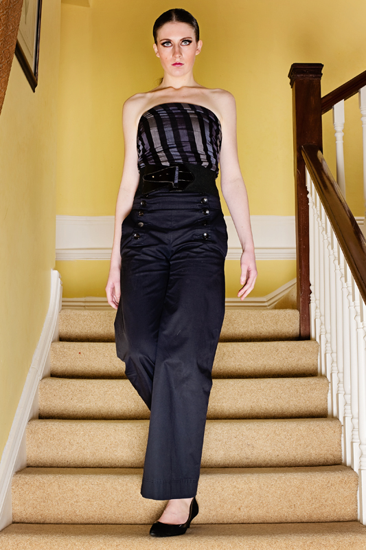 Fashion model walking down stairs