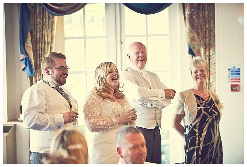 Photo of bride and groom laughter during the wedding speeches in Devon wedding