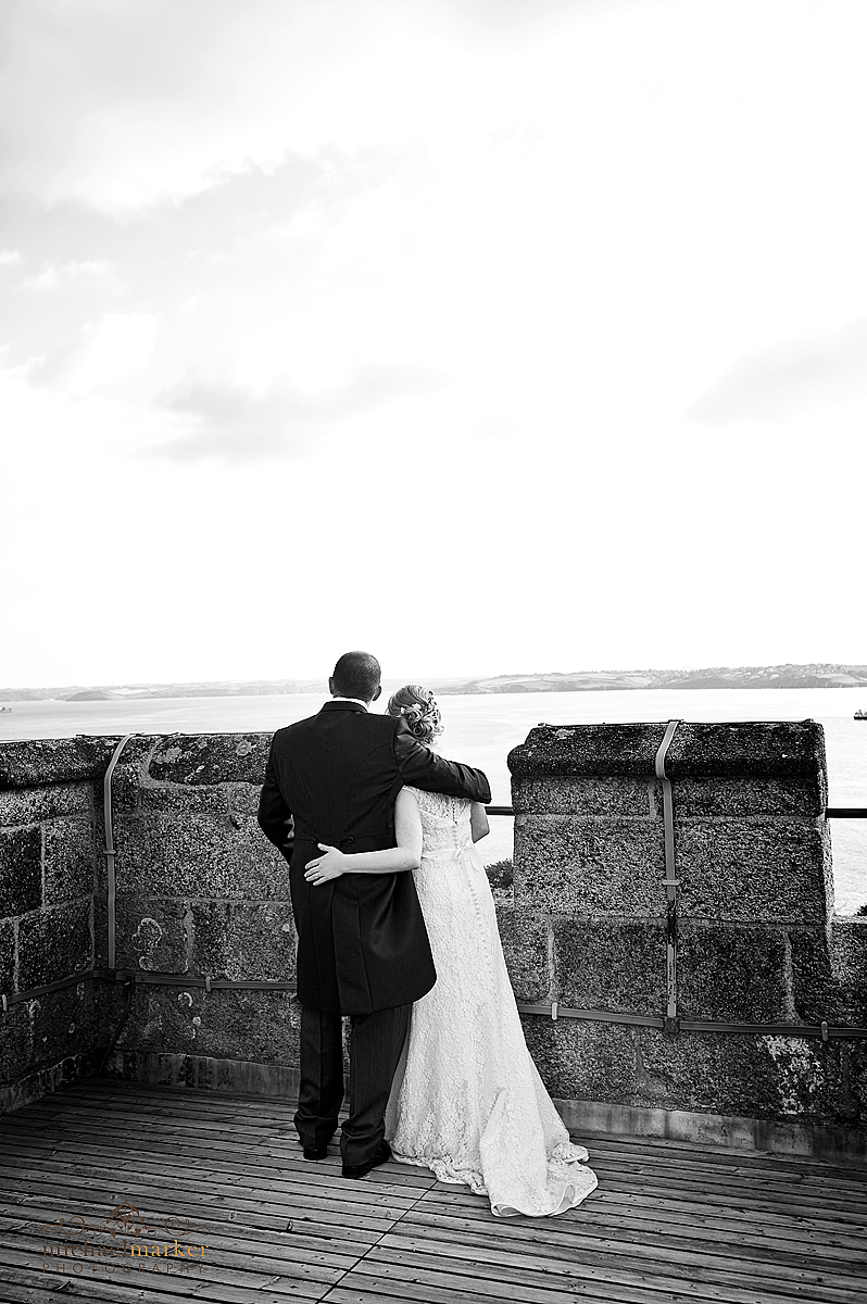 Pendennis Castle wedding photography Bride and groom looking out over Falmouth bay from the top of Pendennis Castle