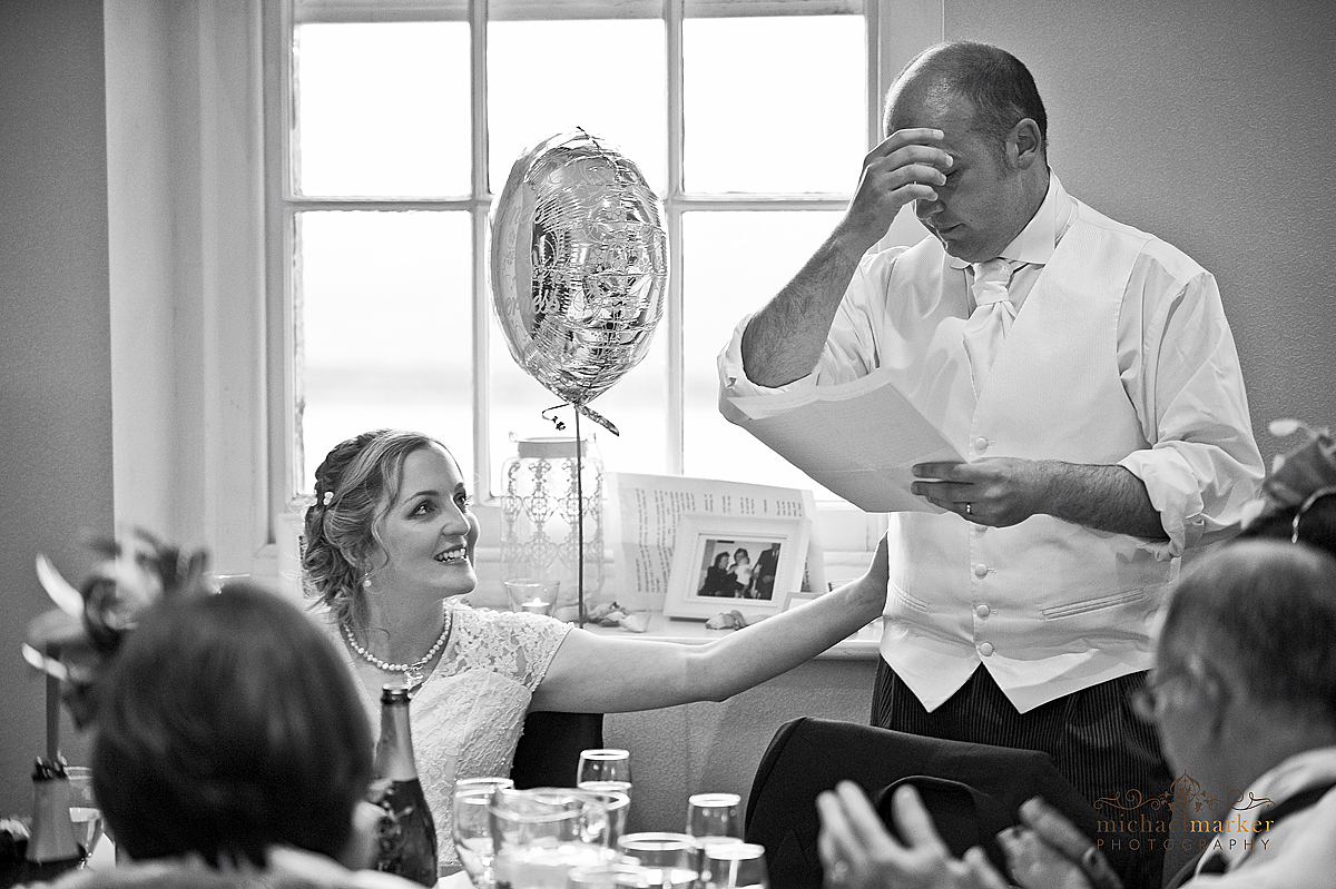 Emotional Falmouth wedding speech by groom with smiling bride