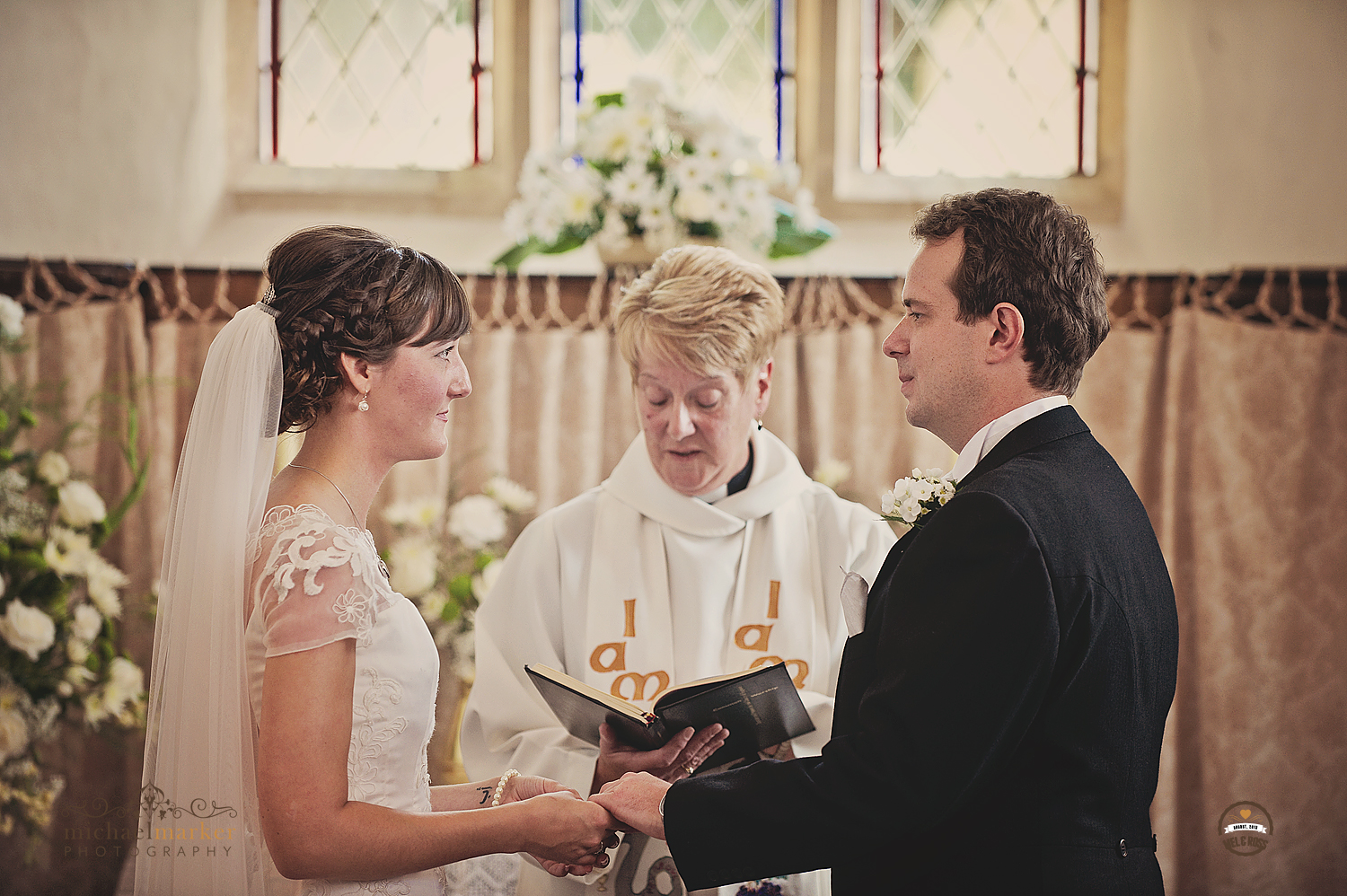 Exchaning wedding vows at Devon chapel wedding