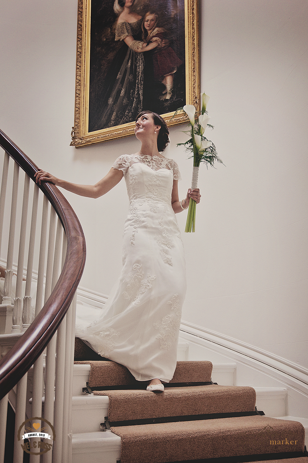 Bride on the stairs at Hallsannery wedding Devon