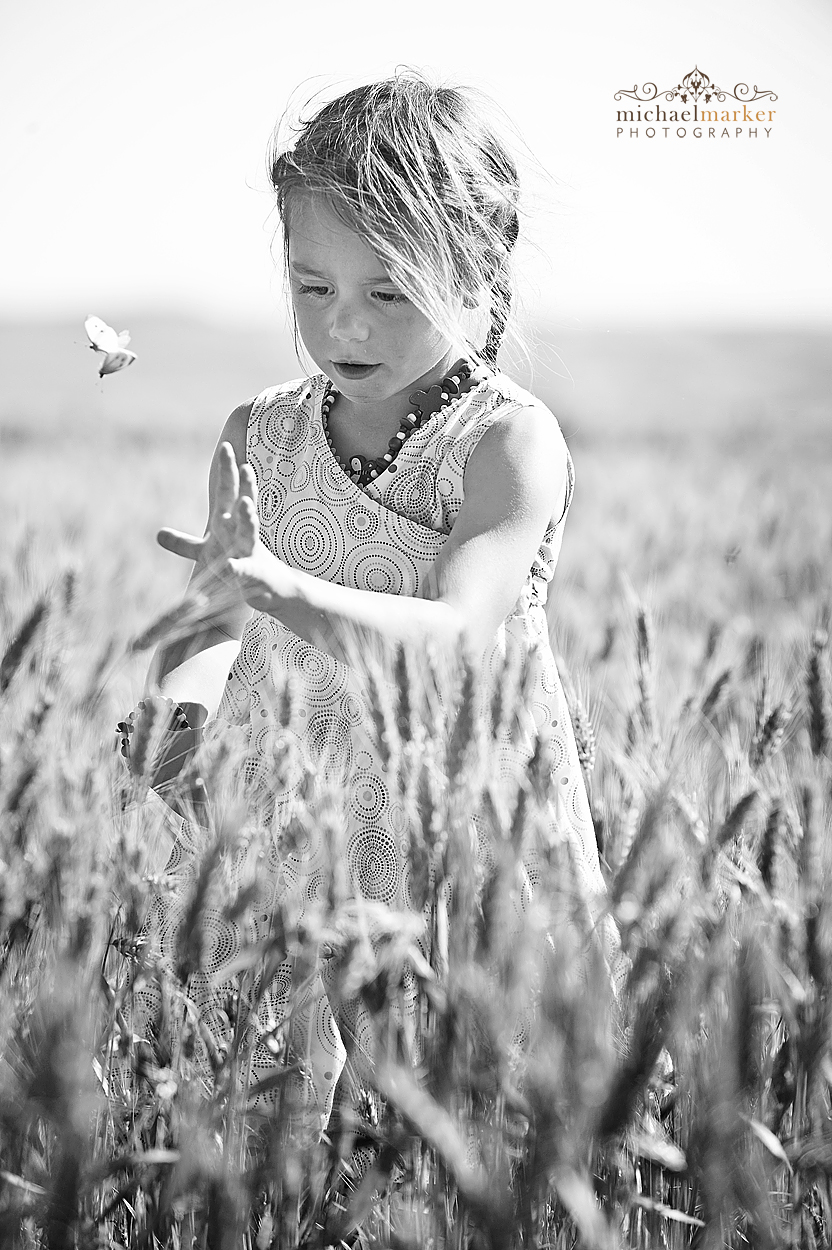 Black and white kids portrait photography in corn field