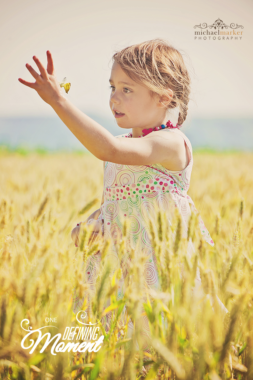 Devon portrait photographer - girl catching a butterfly