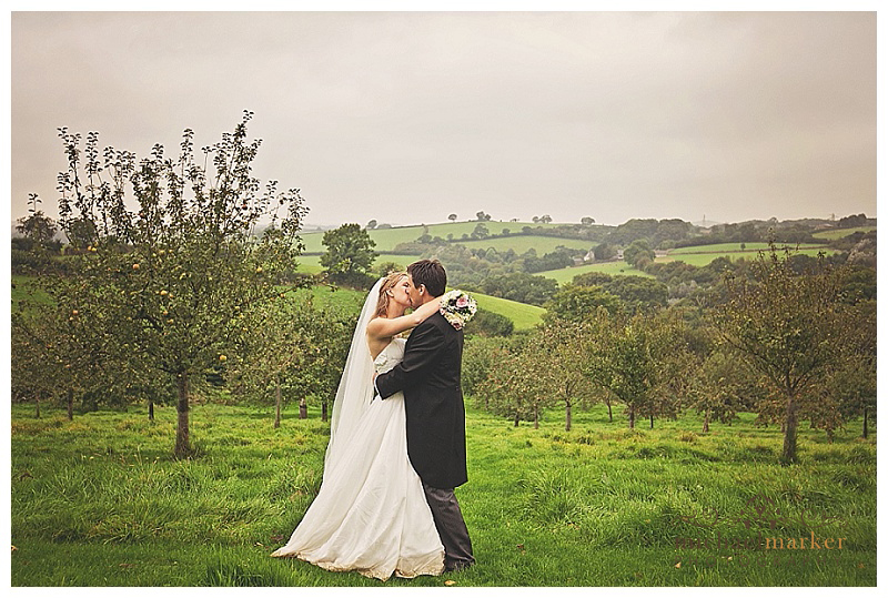 Bride and groom in the orchard at Lantallack House in Cornwall