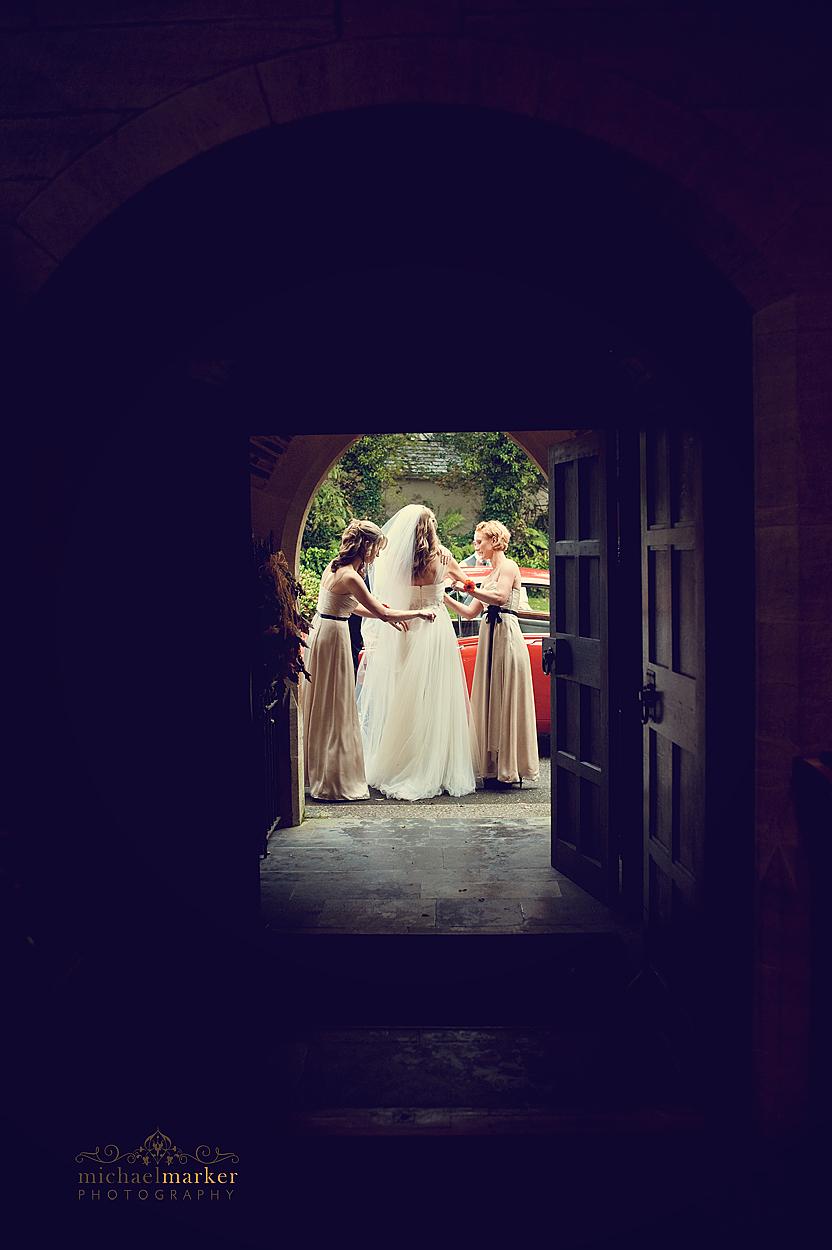 Bride getting ready in Devon church entrance