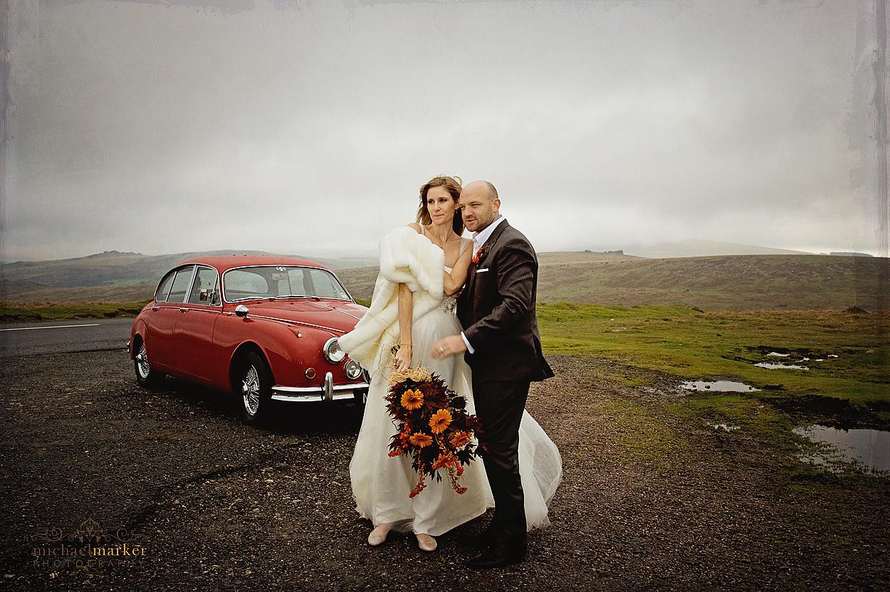 Devon wedding couple on Dartmoor in front of vintage Jaguar car