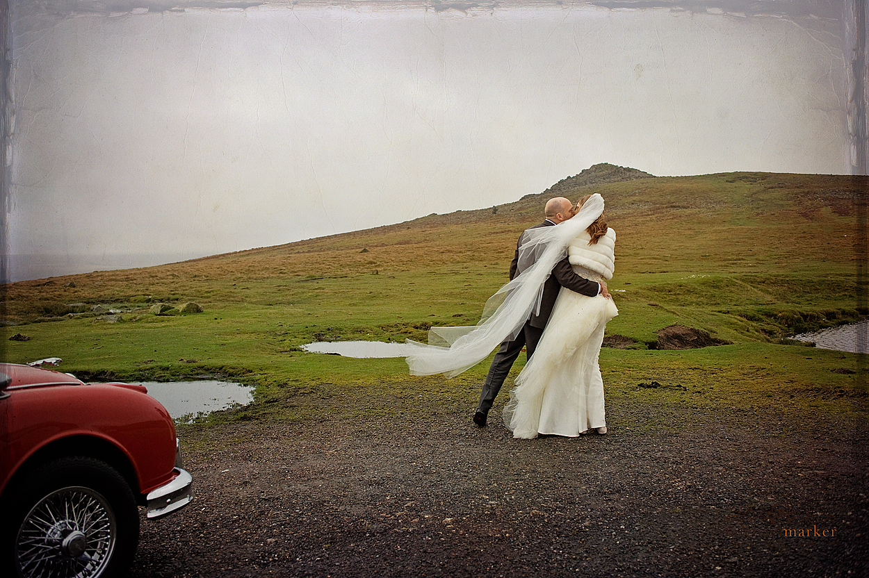 Dartmoor weddign photography in Devon in Autumn with couple in front of Tor