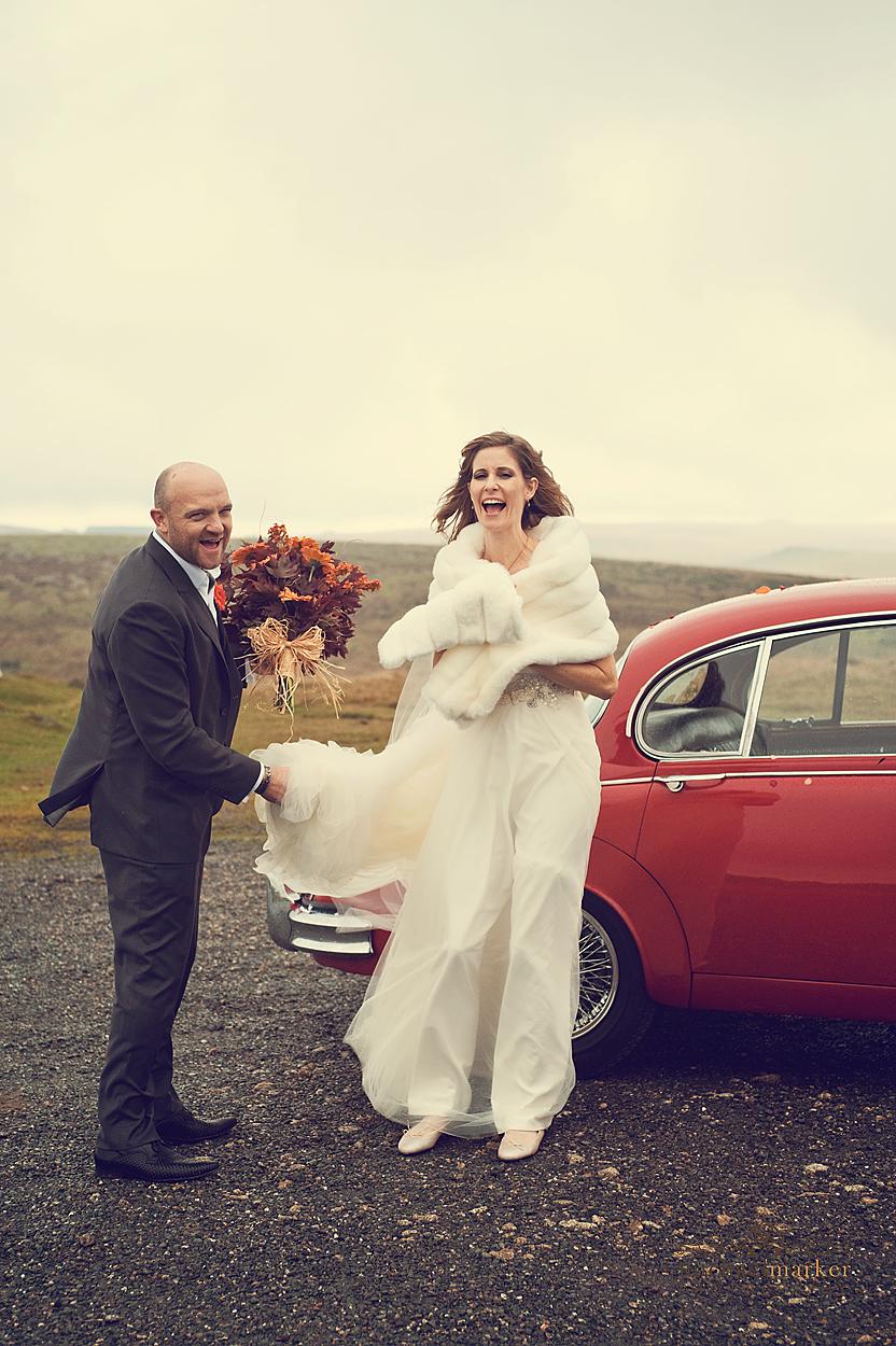 Wedding couple laughing on Dartmoor Devon