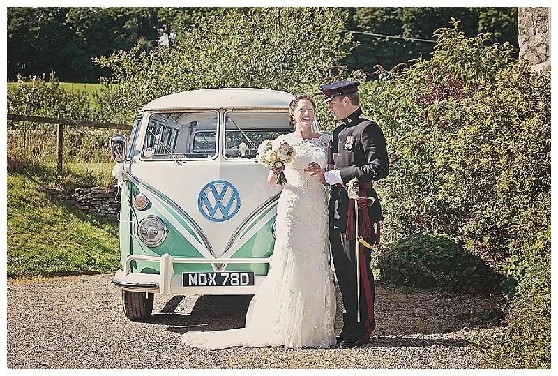 Bride and Groom at Devon farm wedding in front of vintage VW campervan