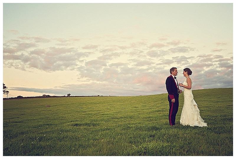Bridal couple in farm field in South Hams Devon