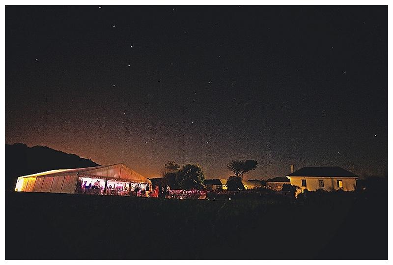 Devon farm wedding marquee photographed at night