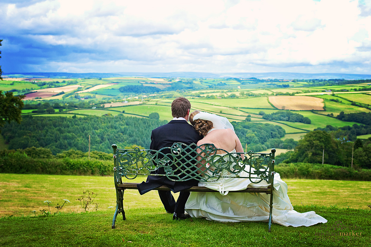 Bride and groom looking at landscape at Northcote Manor wedding in Devon