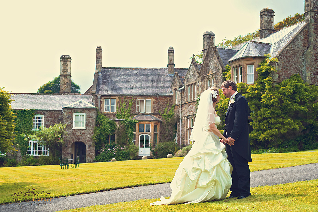 Bride and groom in front of Northcote Manor in Devon at wedding