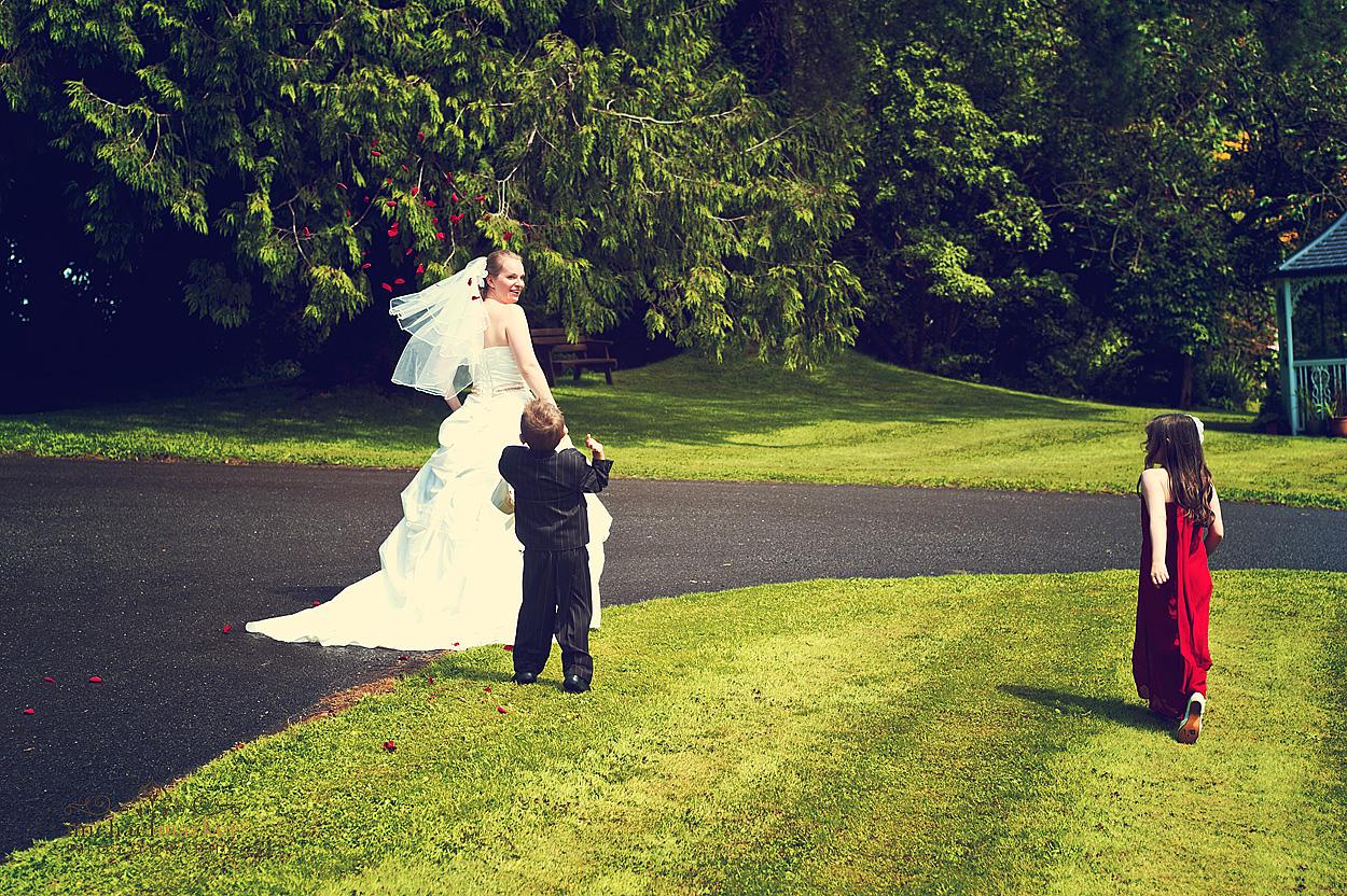 Children throwing confetti at Northcotte wedding in Devon